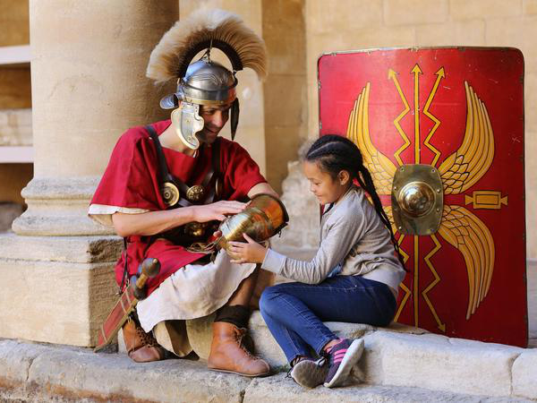 Image: Image: Girl interacting with a costUMed character